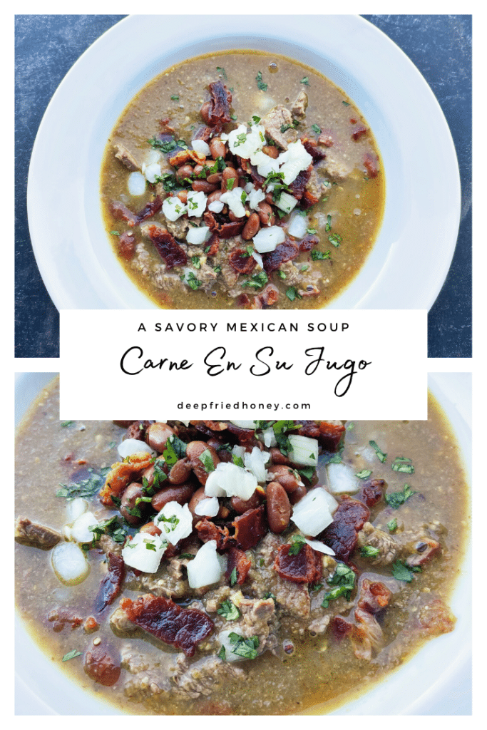 white bowl of Carne en Su Jugo, a mexican stew, topped with bacon, minced cilantro, chopped white onions, and diced crispy bacon.