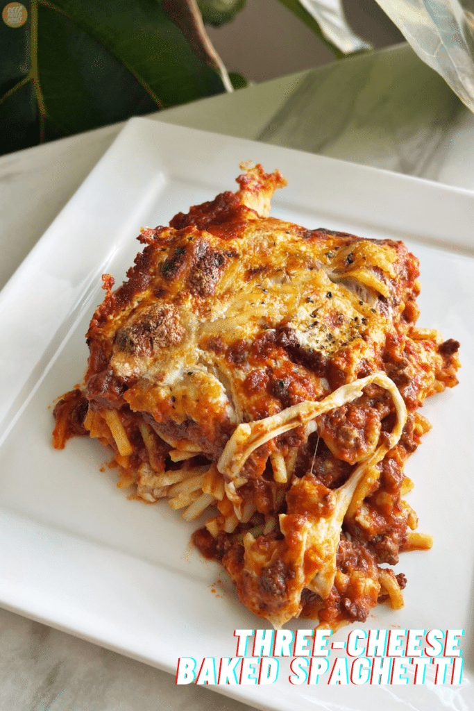 single serving of Three-Cheese Baked Spaghetti on a white square plate.